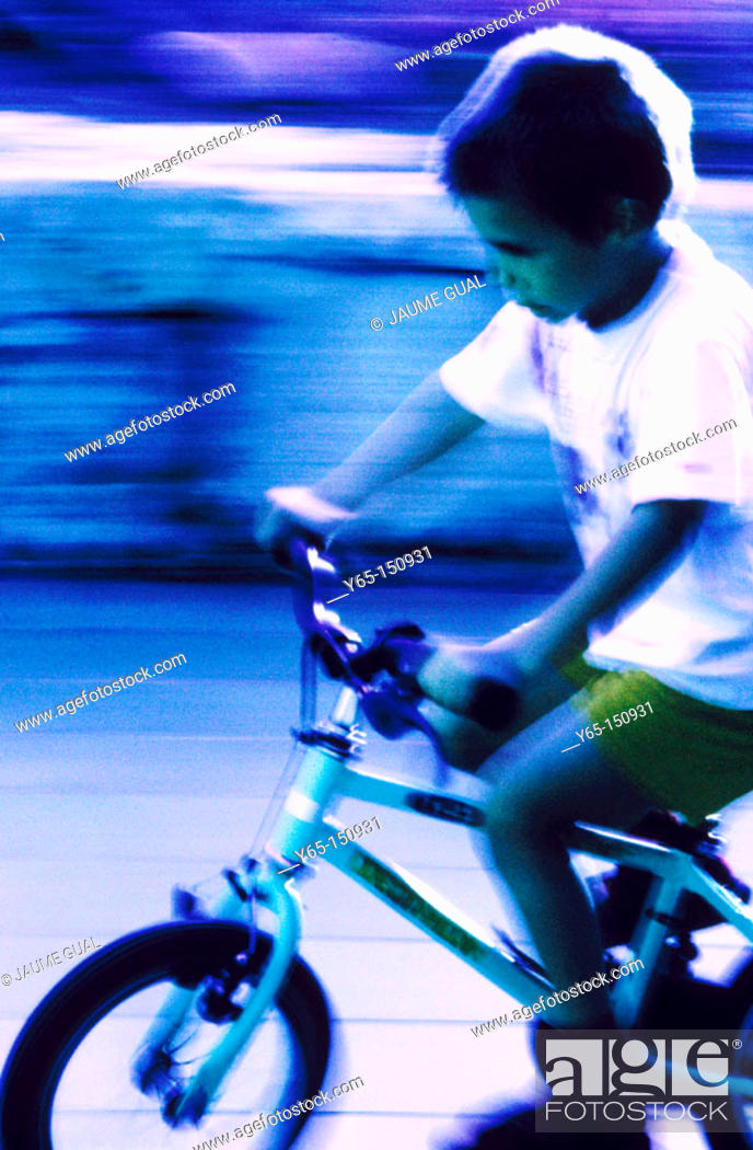 Stock Photo: Boy riding bicycle.