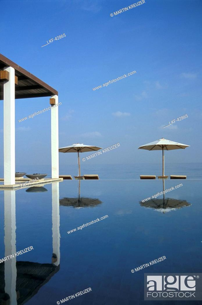 Stock Photo: Sunshades at Chedi Pool in the sunlight, The Chedi Hotel, Muscat, Oman, Middle East, Asia.