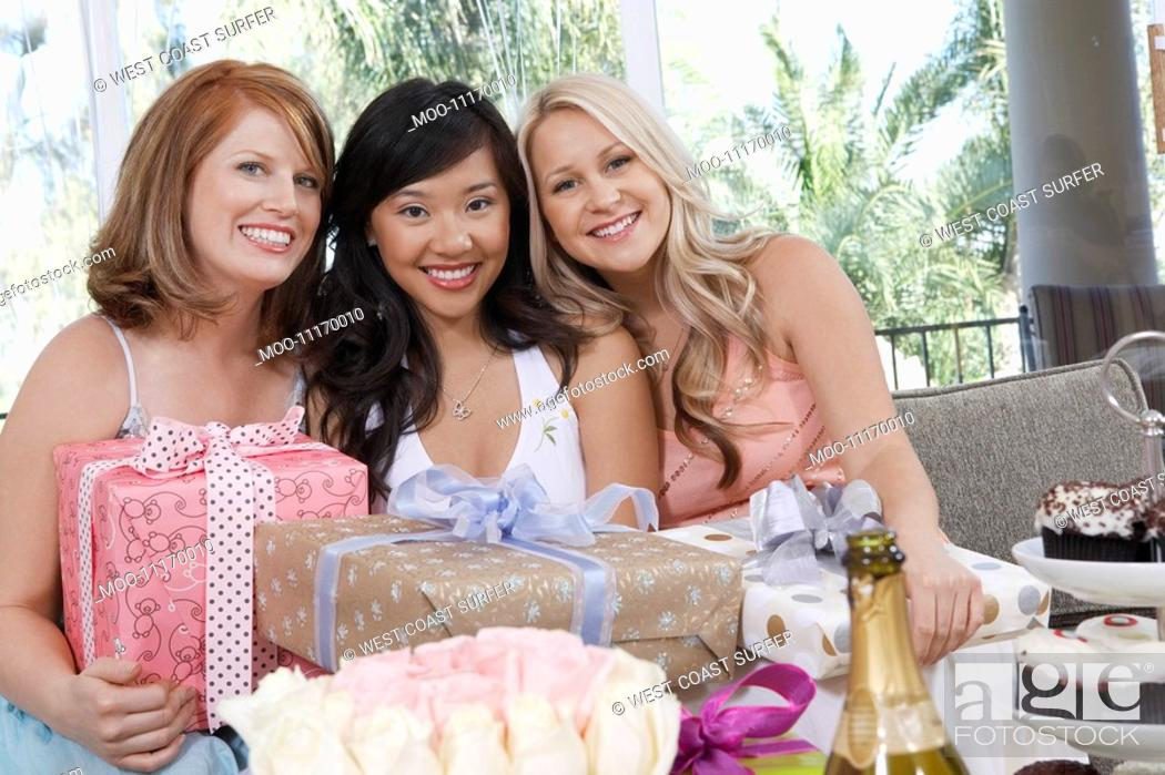 Stock Photo: Friends sitting Together with gifts at Bridal Shower.