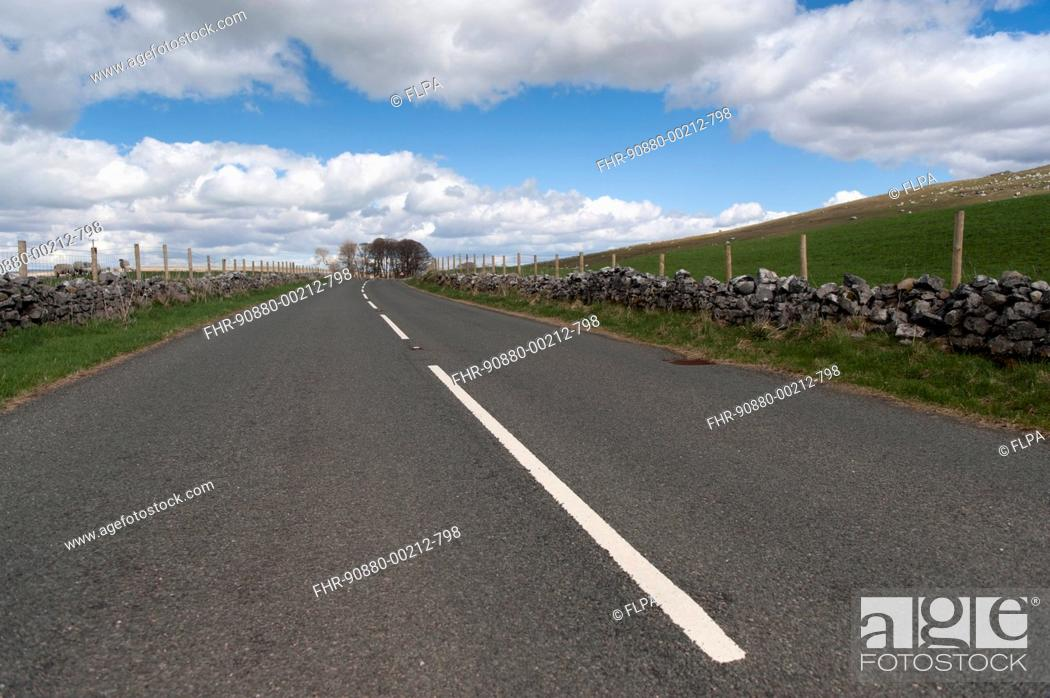 Stock Photo: Road through countryside, A683 between Sedbergh and Kirkby Stephen, Cumbria, England, April.