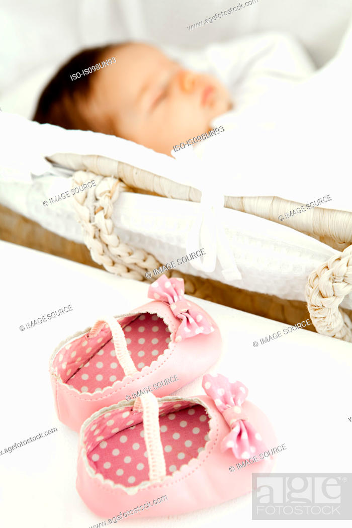 Stock Photo: Baby girl shoes and baby sleeping.
