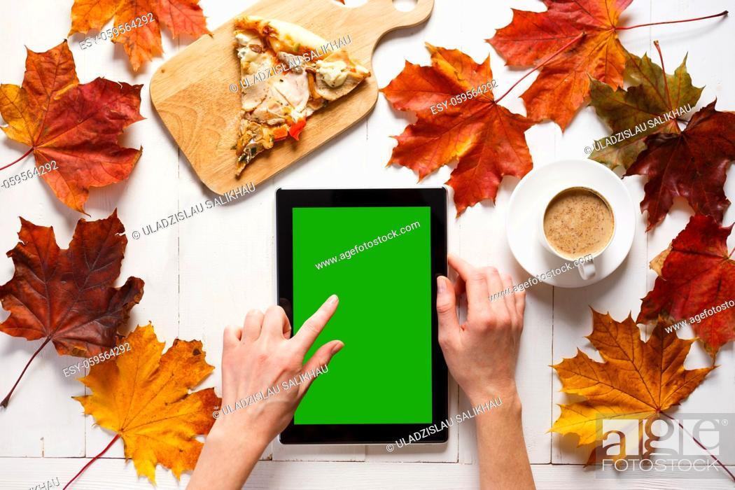 Photo de stock: Autumn morning of contemporary young woman. Portable pc tablet, coffee and pizza on white timber table. Top view.