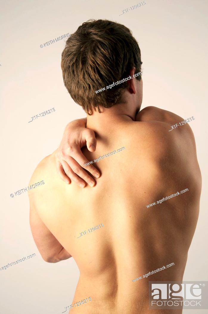 Stock Photo: White caucasian male man suffering from back ache pain.