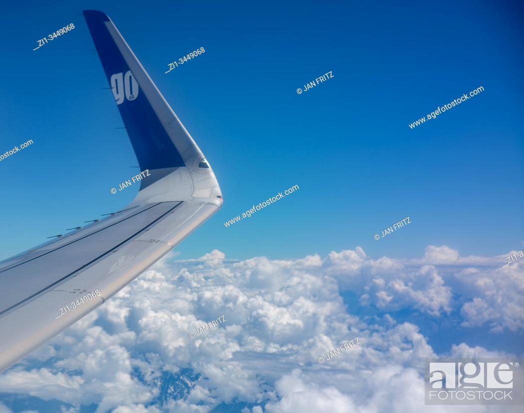 Imagen: aerial view of clouds and blue sky with wing from plane.