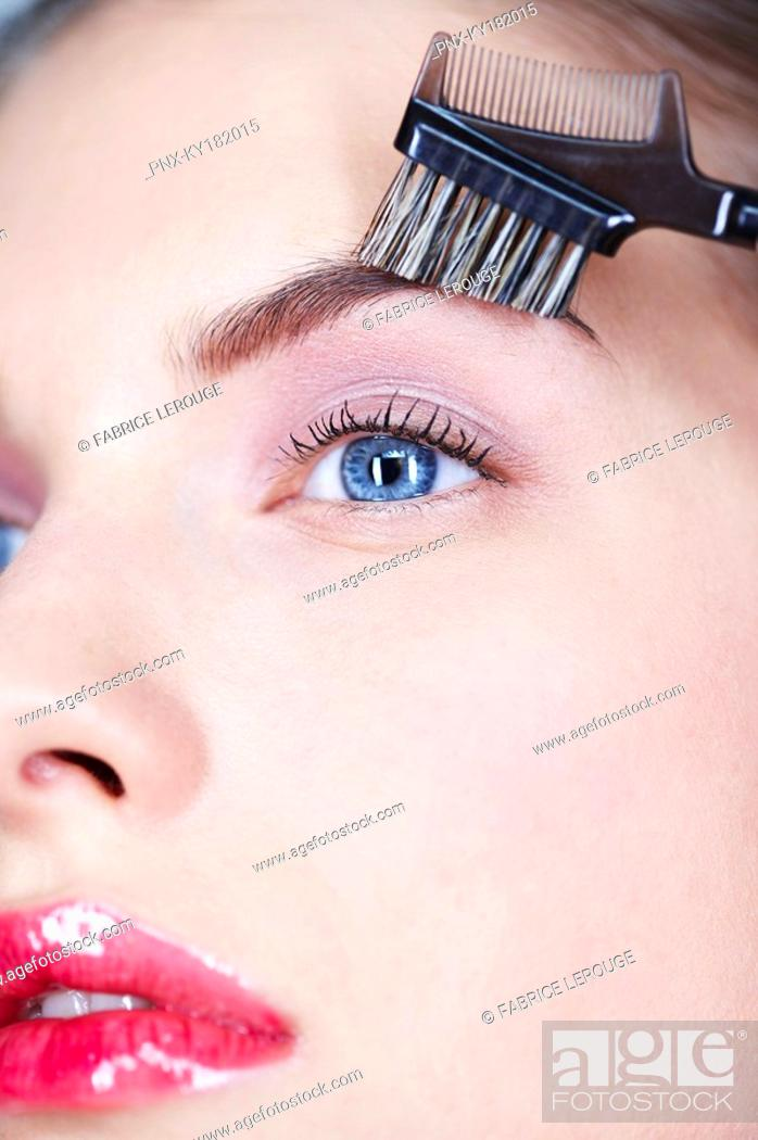 Stock Photo: Woman brushing eyebrow.