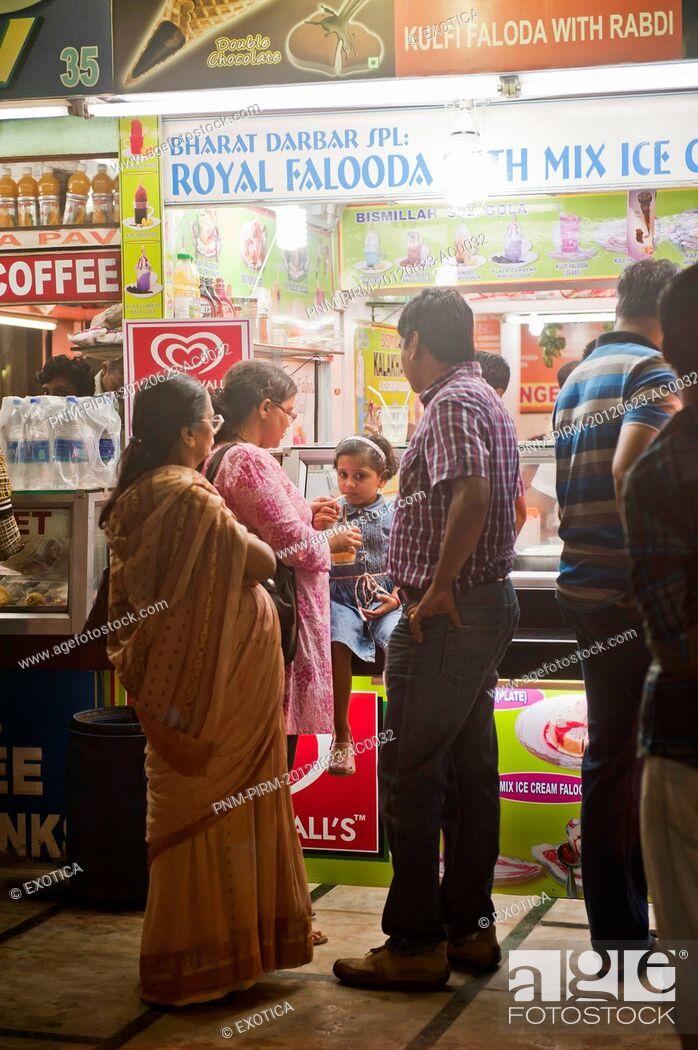 Stock Photo: People at an ice cream parlor, Juhu Beach, Mumbai, Maharashtra, India.