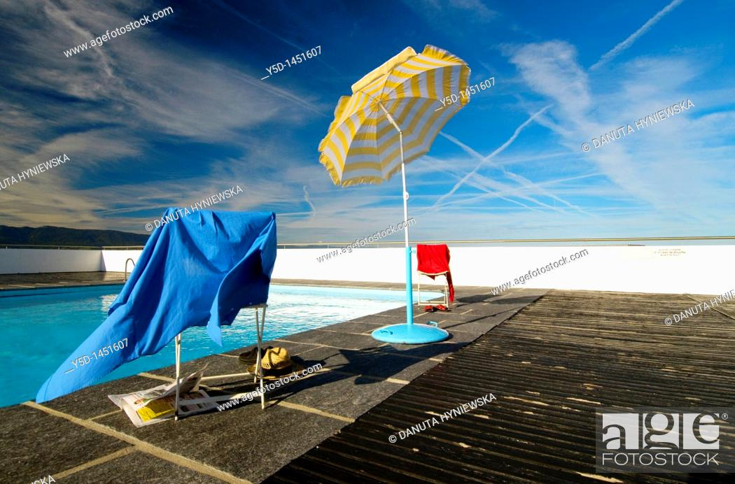 Stock Photo: empty swimming pool, the end of summer, wind, sky, clothes, Geneva, Switzerland.