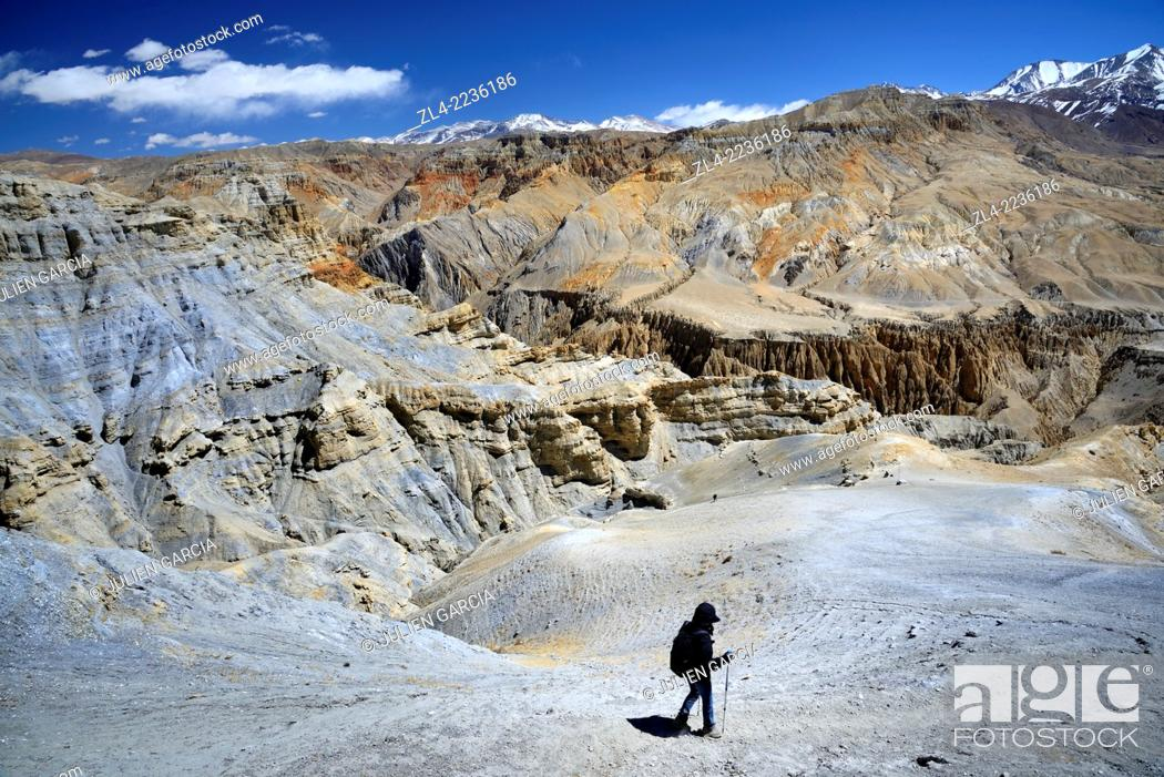 Stock Photo: Trekker and mineral landscape between Lo Manthang and the village of Dhie Gaon. Nepal, Gandaki, Upper Mustang (near the border with Tibet).