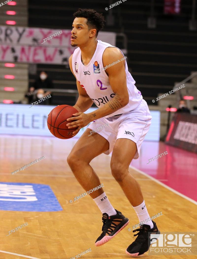 Stock Photo: Bonn, Germany, 27. 12. 2020, Telekom Dome, Basketball Bundesliga, Telekom Baskets Bonn vs BG Goettingen: Nelson Weidemann (Goettingen) controls the ball.