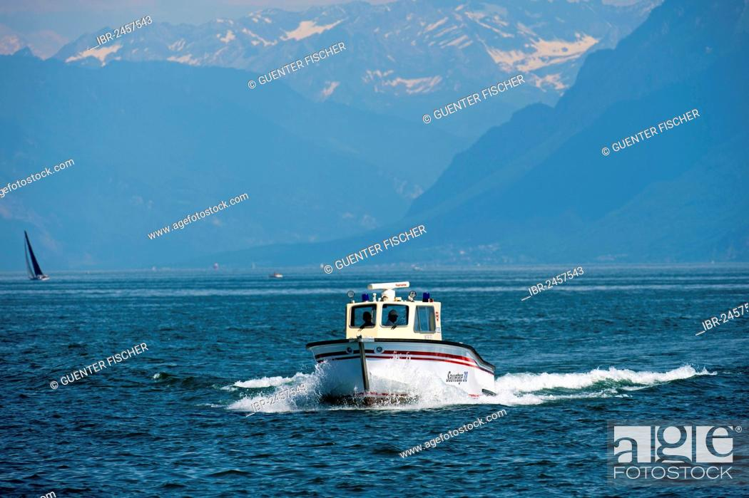 Stock Photo: Water rescue motor boat of Morges on Lake Geneva, near Morges with the Vaud Alps at back, Alpes vaudoises, Canton Vaud, Switzerland, Europe.