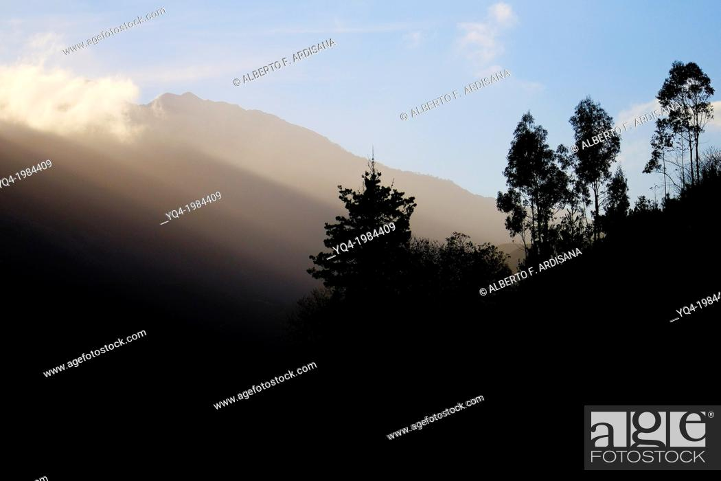 Stock Photo: Light filters through the clouds, illuminating the valley of La Borbolla, in Llanes, Asturias, Spain.