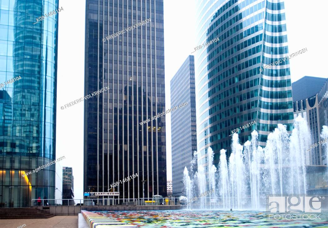 Stock Photo: EDF tower and fountain by Yaakov Agam, La Defense business district, Paris, France.