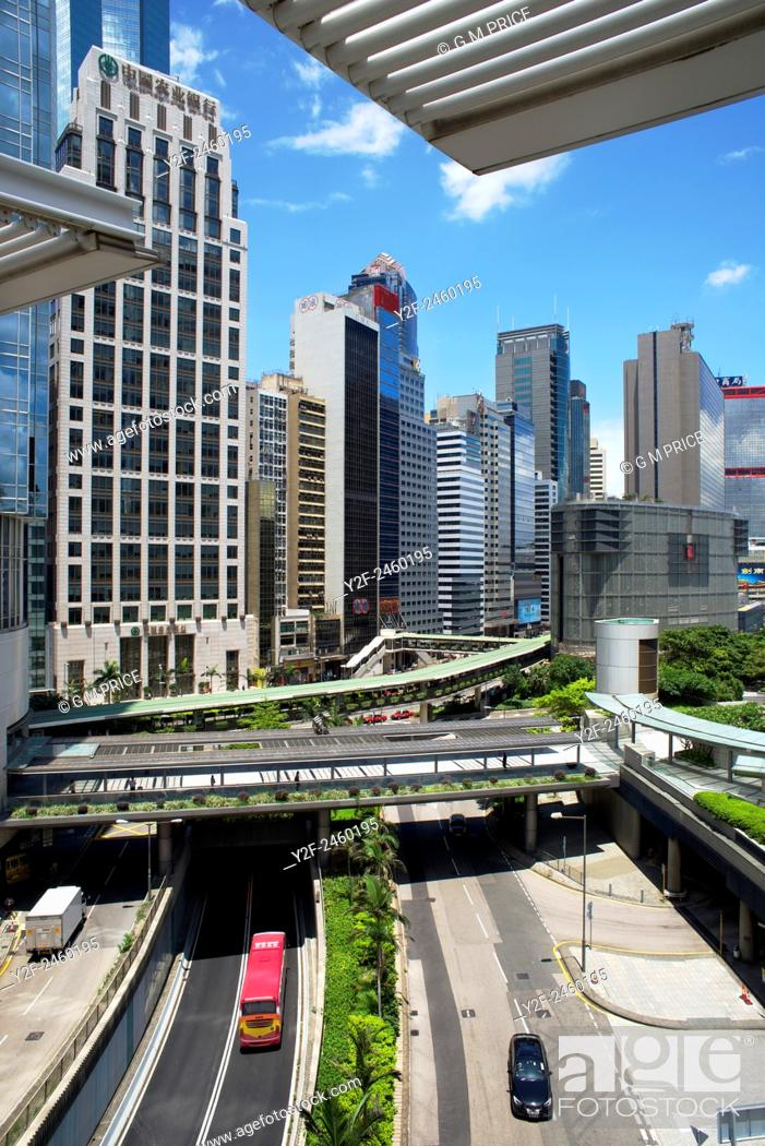 Stock Photo: Hong Kong office buildings and roadway seen from roof of International Finance Centre mall.