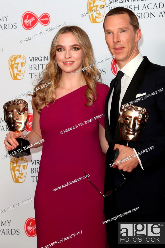 Stock Photo: May 12, 2019 - London, London, United Kingdom - Image licensed to i-Images Picture Agency. Benedict Cumberbatch with his Leading Actor award and Jodie Comer.