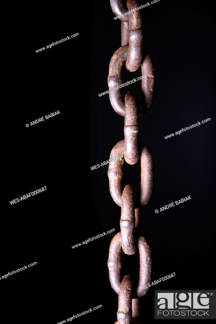 Stock Photo: Chain against black background, close up.