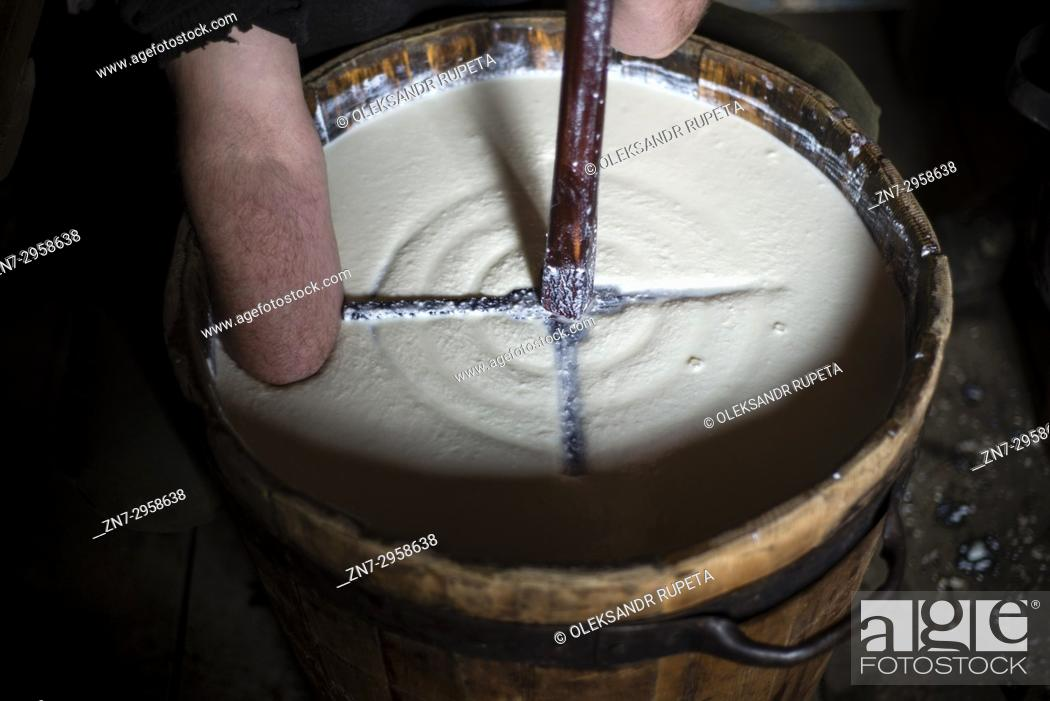 Stock Photo: Shepherds make sheep's milk cheese. Late spring, when shepherds go to Carpathian mountain valleys all villagers come to celebrate it together.