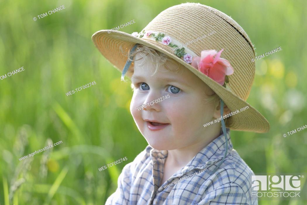 Stock Photo: Germany, Bavaria, Boy looking away, smiling.
