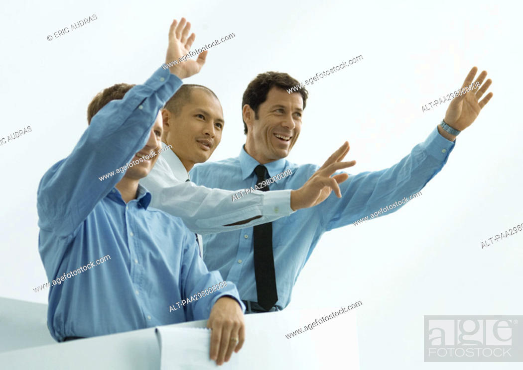 Stock Photo: Three businessmen waving.