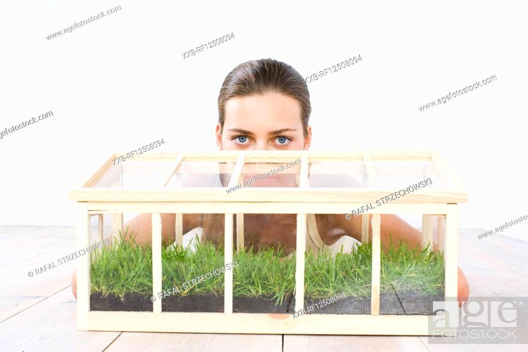 Stock Photo: woman growing grass in the box.