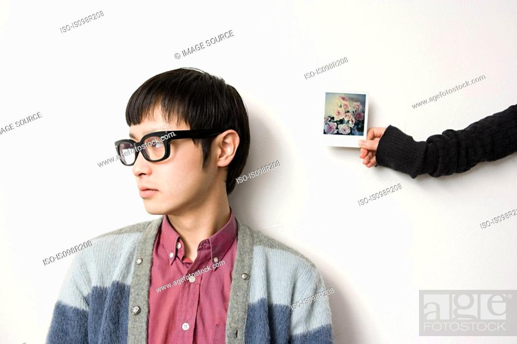 Stock Photo: Young man and photograph.