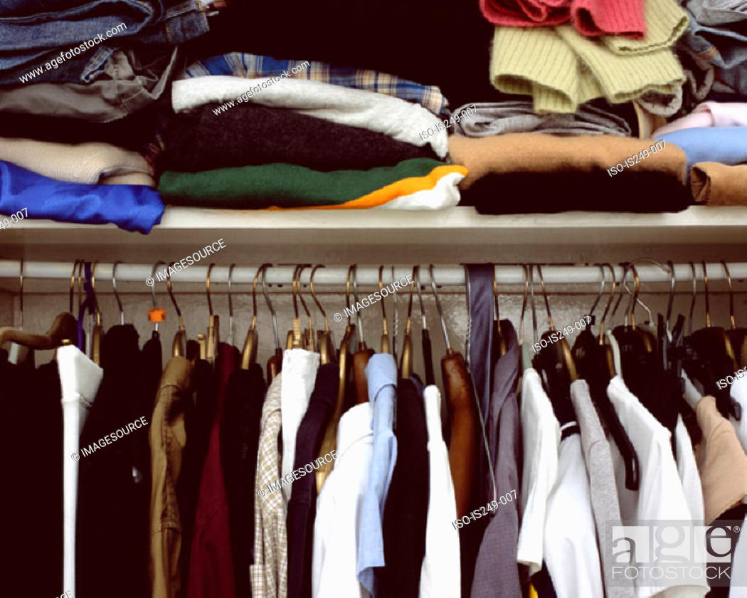 Stock Photo: Clothes in cupboard.