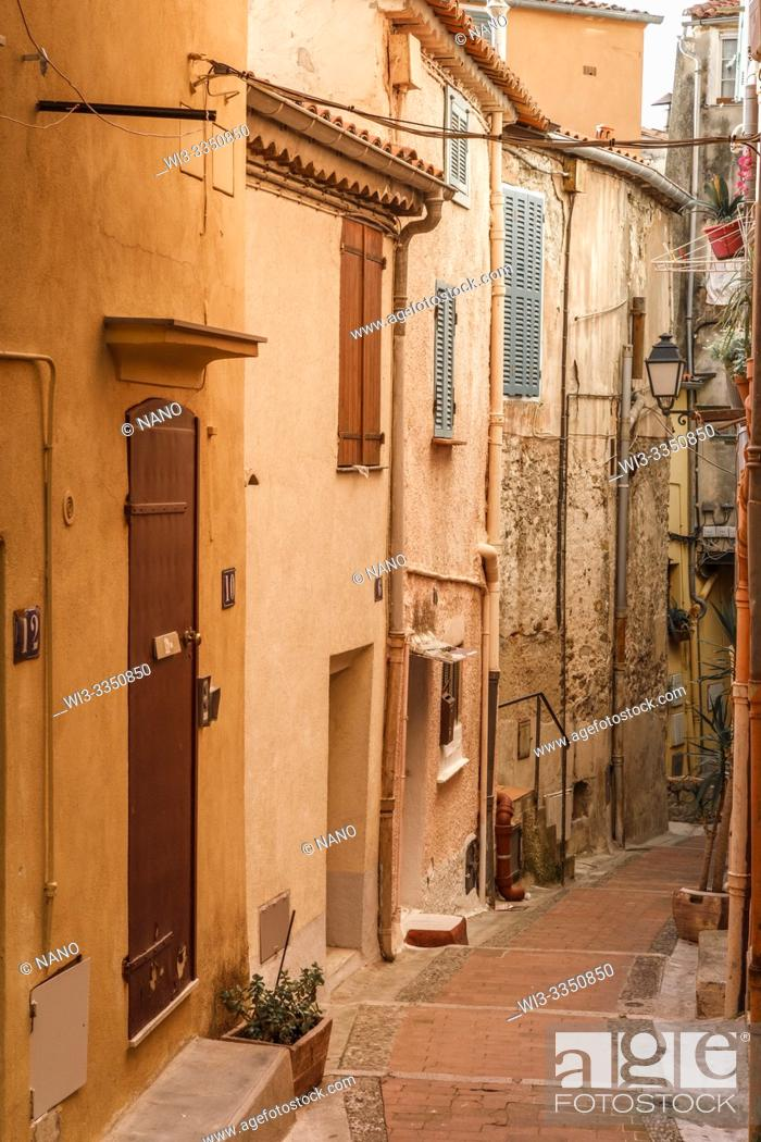 Stock Photo: France, Alpes Maritimes, Menton, alley with steps in the old town.