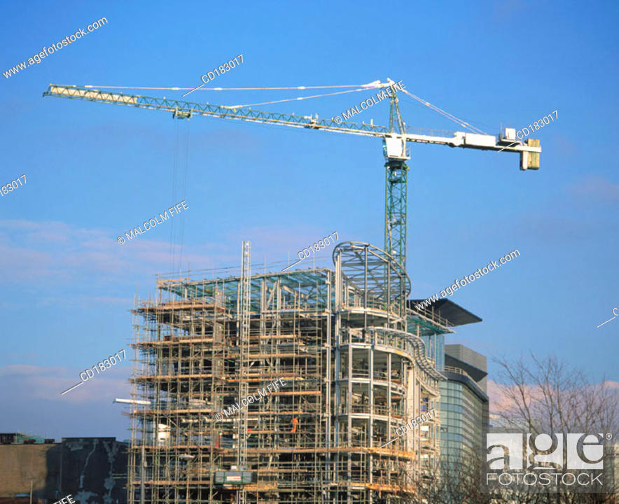 Stock Photo: Construction crane and office block under construction.
