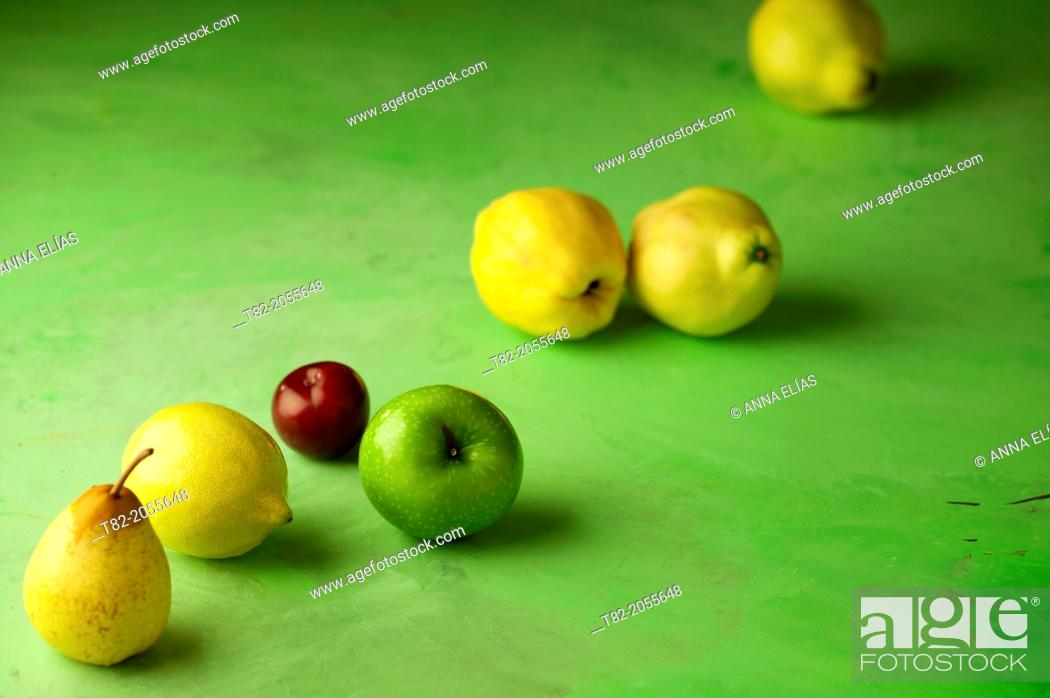 Stock Photo: fruit yellow, green and red diagonal green background.