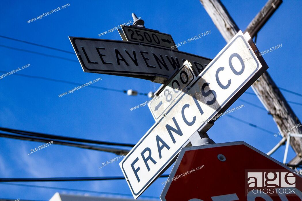 Stock Photo: View of white streets signs in San Francisco of an intersection on a blue sky sunny day.