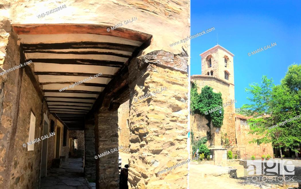 Stock Photo: Arcade and church. Plaza Mayor, Yanguas, Soria province, Castilla Leon, Spain.