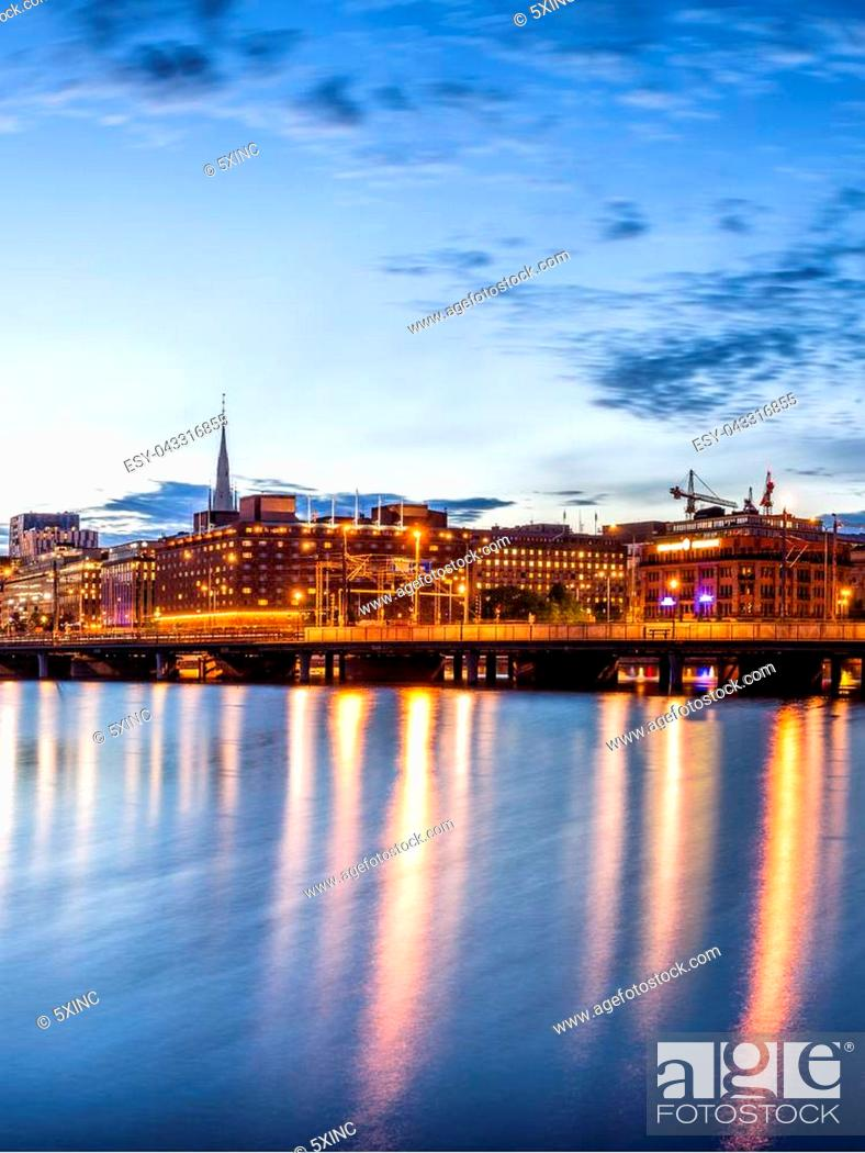 Stock Photo: Stockholm sunset skyline with City Hall as seen from Riddarholmen.