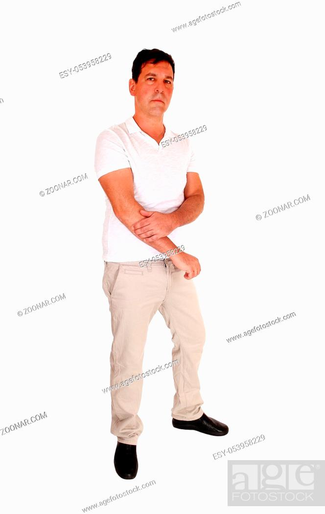 Stock Photo: A tall handsome middle age man standing in beige slacks and white t-shirt looking serious, isolated for white background.