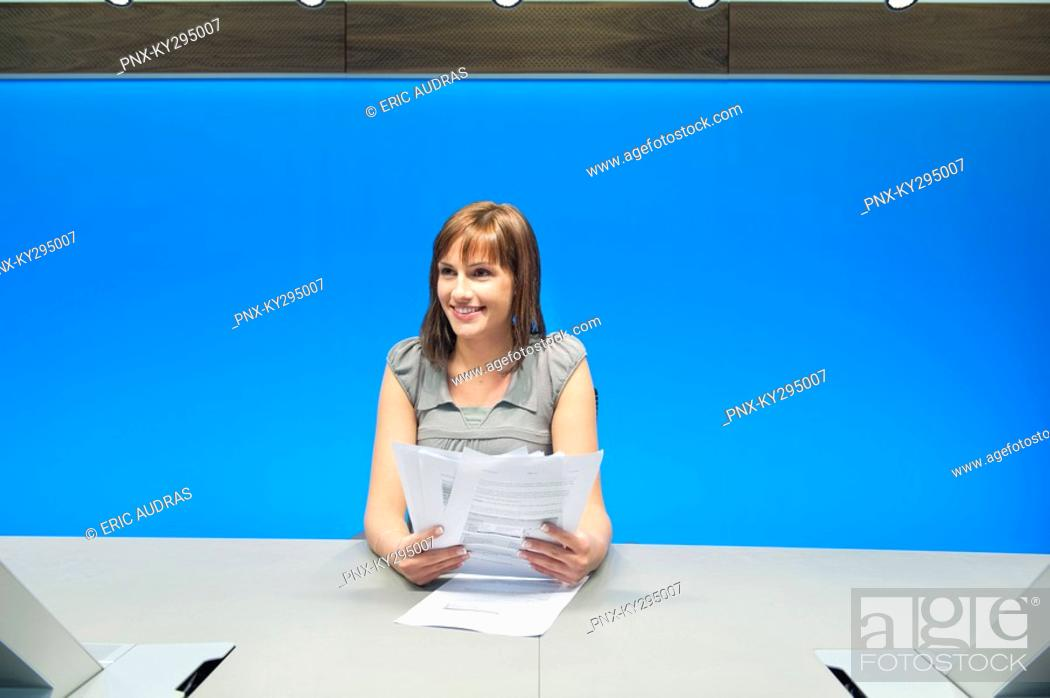 Stock Photo: Businesswoman doing paperwork in a conference room.