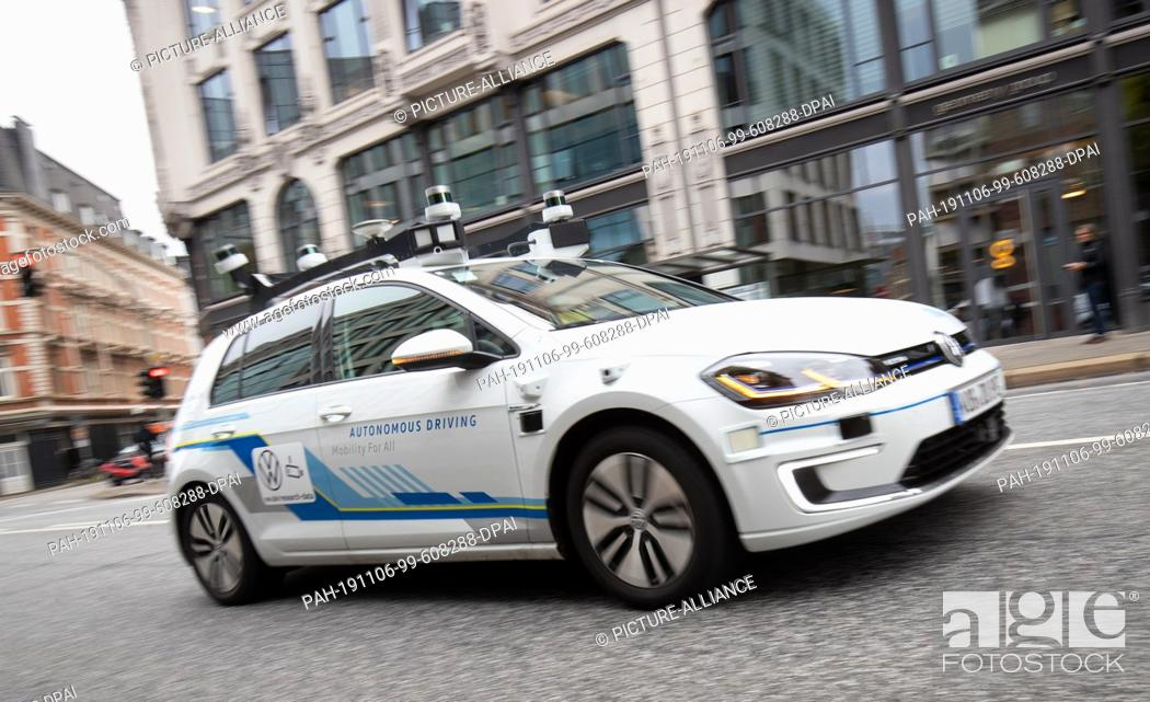 Stock Photo: 06 November 2019, Hamburg: An electric Golf, equipped with laser scanners, cameras, ultrasonic sensors and radar for fully automatic driving.