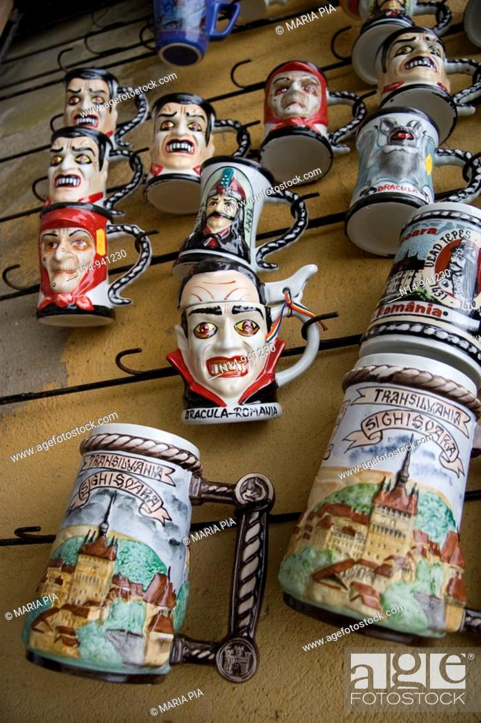 Stock Photo: Mugs decorated with Vlad Tepes also known as Dracula on sale in the old town of Sighisoara, Transylvania. Romania.