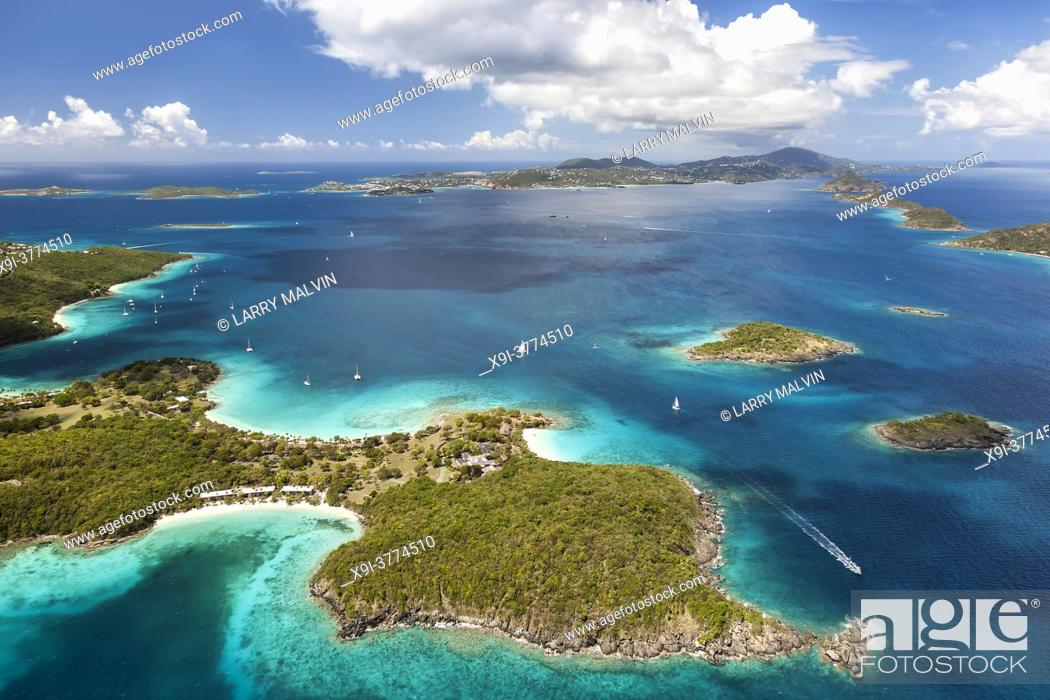 Stock Photo: Aerial view of Caneel Bay on the island of St. John with St. Thomas in the distance in the United States Virgin Islands.