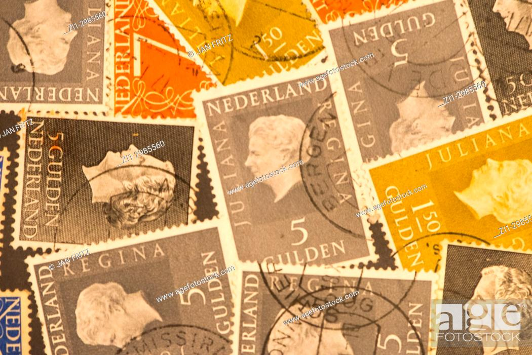 Stock Photo: former cents and guilders stamps of Holland.