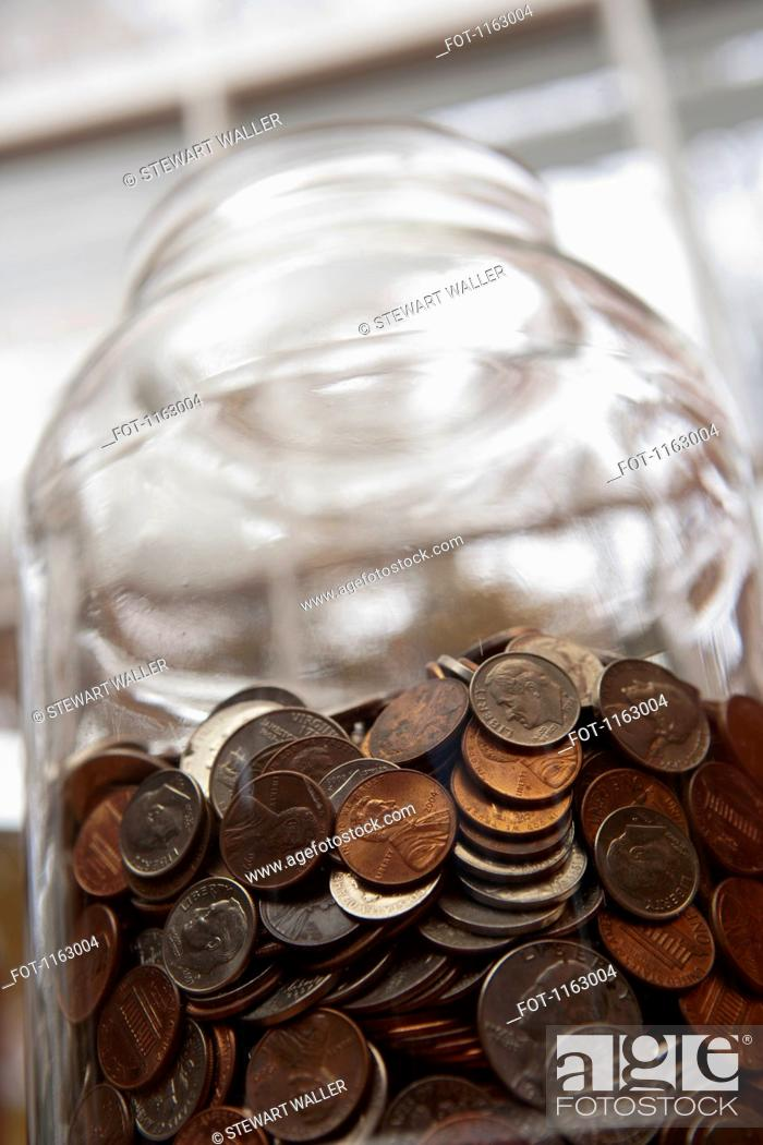 Stock Photo: Money jar of US coins.