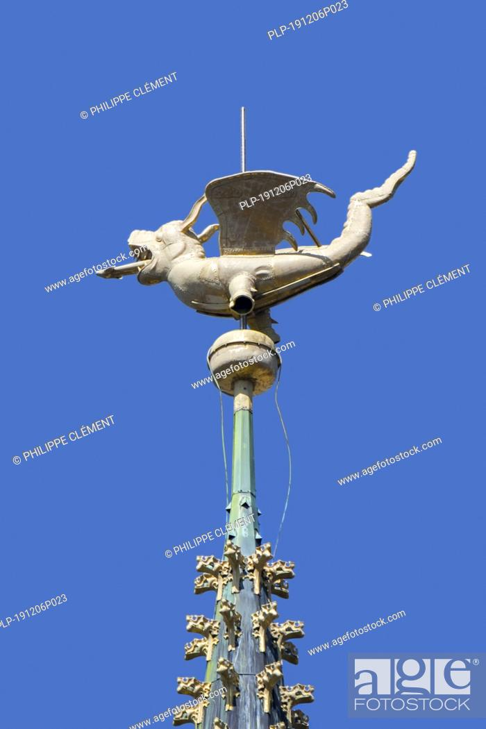 Stock Photo: Dragon on spire of the belfry of Ghent / Gent against blue sky, East Flanders, Belgium.