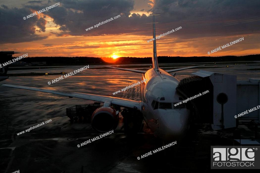Stock Photo: Aeroplane on airport at sunset.