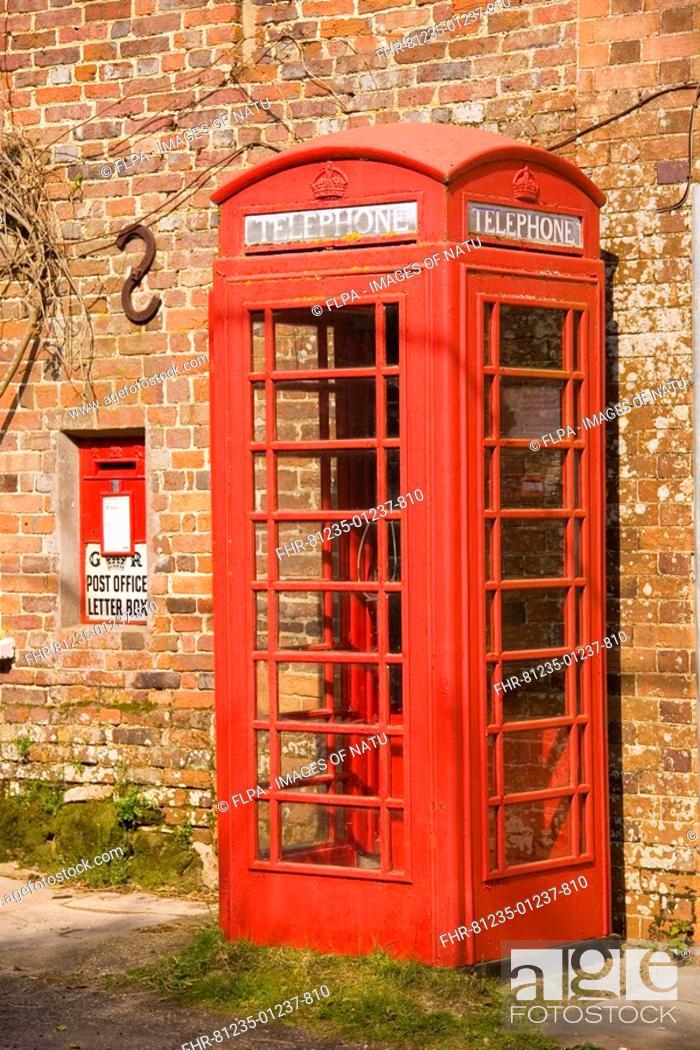 Stock Photo: Red telephone box and postbox, Moreton, Dorset, England.
