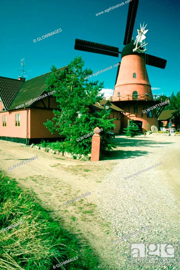 Stock Photo: Windmill and a restaurant on a country road, Funen County, Denmark.