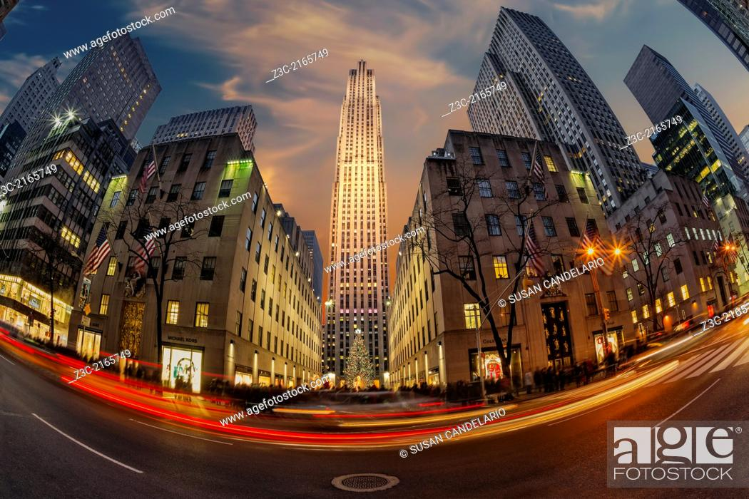 Stock Photo: A fishe eye view during sunset to Rockefeller Center with the decorated and illuminated iconic Christmas Tree.
