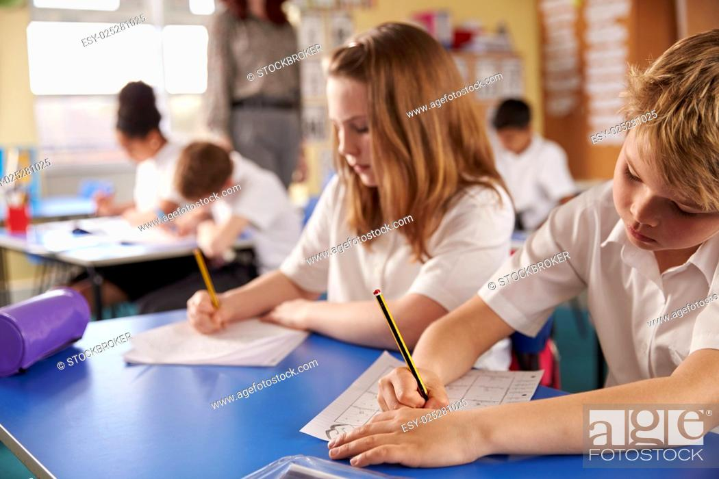 Stock Photo: Boy and girl working in primary school class, close up.
