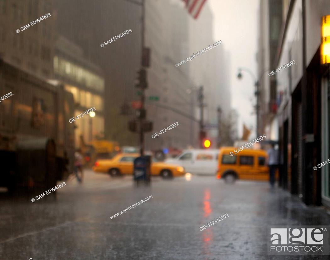 Stock Photo: Blurred view of rainy city street.