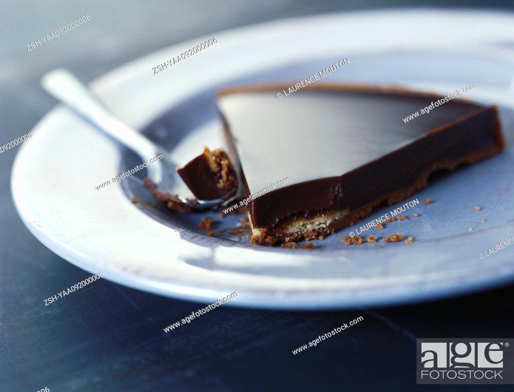 Stock Photo: Slice of chocolate tart with spoon.