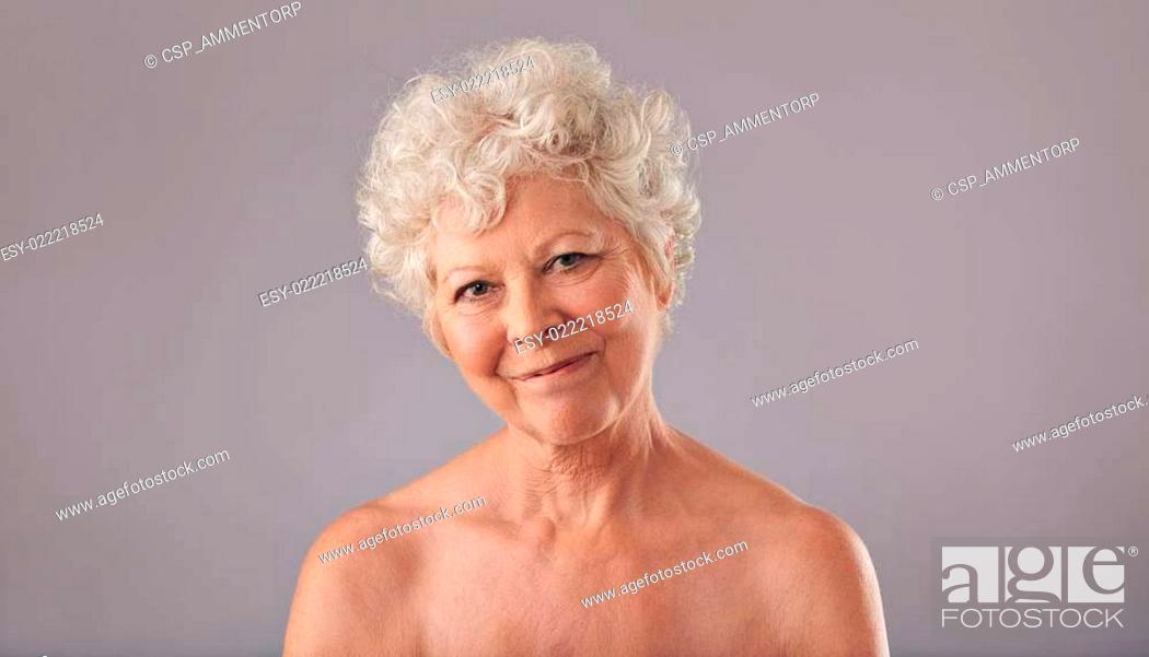 Stock Photo: Attractive old woman looking happy.