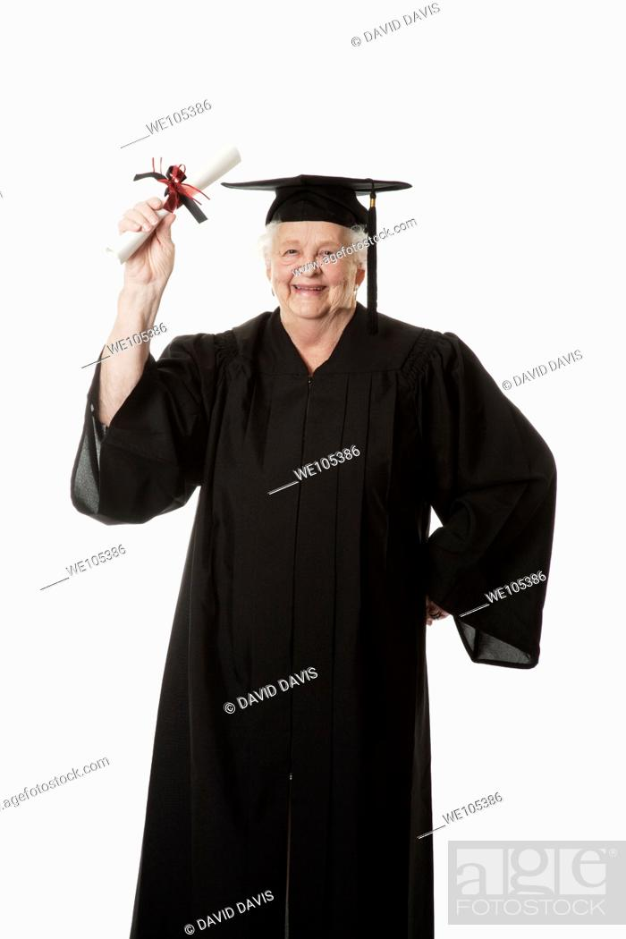 Stock Photo: Beauitiful Caucasian woman in a black graduation gown.