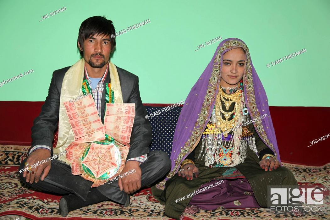 Muslim Bride And Groom In Traditional Attire During Their Wedding In