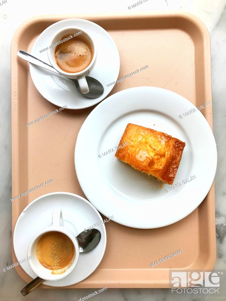 Stock Photo: Two cups of coffee and piece of cake on a tray. View from above.